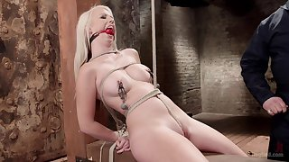 Hot blonde clamped by the tits and fucked while fully restrained