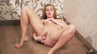Horny Nata Nice fingers her shaved little pussy in place of baking