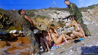 Amazing outdoors group sex surpassing the shore with team a few sexy models